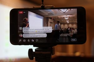 Mobile screen showing a virtual meeting with live comments